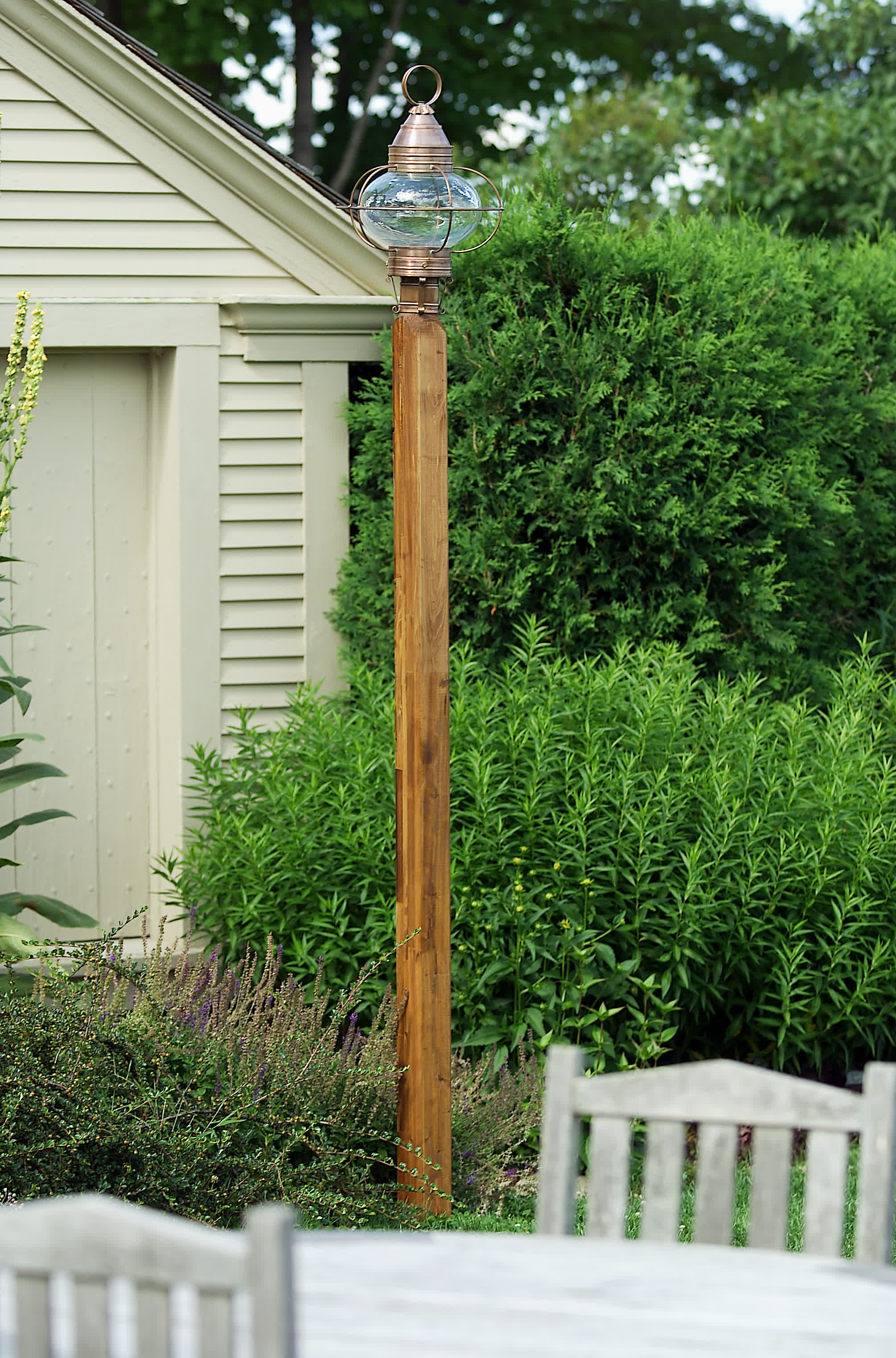 Hammerworks Colonial Onion Post Lantern Handcrafted With Solid Copper POL12 Shown On A Cedar Wooden Light Pole
