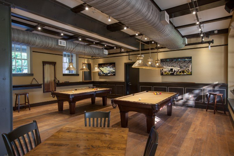 Custom Pool Table Light Shown With 3 Brass Punched Shades Hanging On A 6 Foot Brass Bar Handcrafted By Hammerworks
